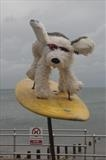 It's A Dog's Life by Jane Burt, Sculpture, Stuffed dog, frame and surfboard